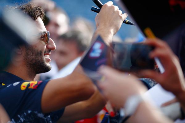 Hungaroring, Budapest, Hungary.  Thursday 27 July 2017. Daniel Ricciardo, Red Bull Racing, signs autographs for fans.  World Copyright: Andy Hone/LAT Images  ref: Digital Image _ONZ7995