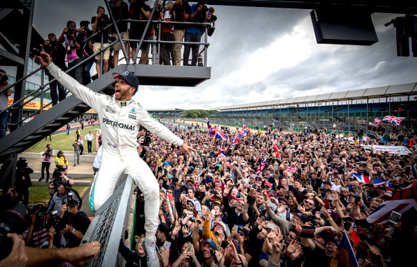 Silverstone, Northamptonshire, UK.  Sunday 16 July 2017. Lewis Hamilton, Mercedes AMG, 1st Position, celebrates victory with the British fans. World Copyright: Dunbar/LAT Images  ref: Digital Image _X4I8707
