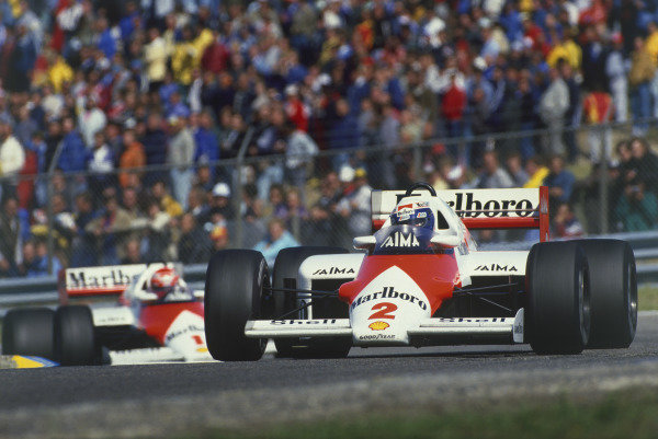 Zandvoort, Holland. 23-25 August 1985. Alain Prost leads Niki Lauda (both McLaren MP4/2B TAG Porsche). Ref: 85HOL39. World Copyright - LAT Photographic