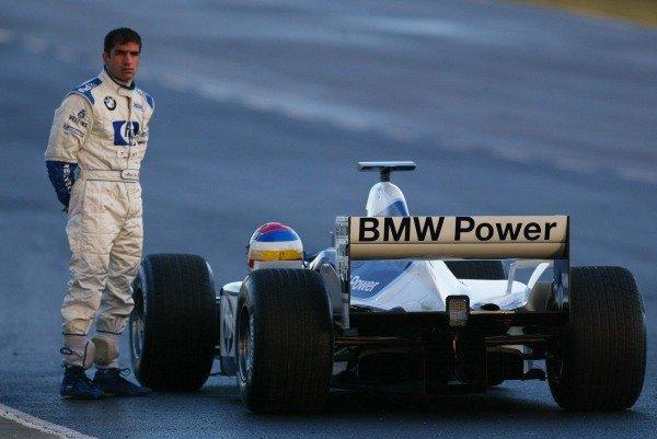 Marc Gene (ESP) Williams Test Driver stands beside his stricken Williams.Formula One Testing , 12 - 15 December 2002Jerez, Spain.DIGITAL IMAGE