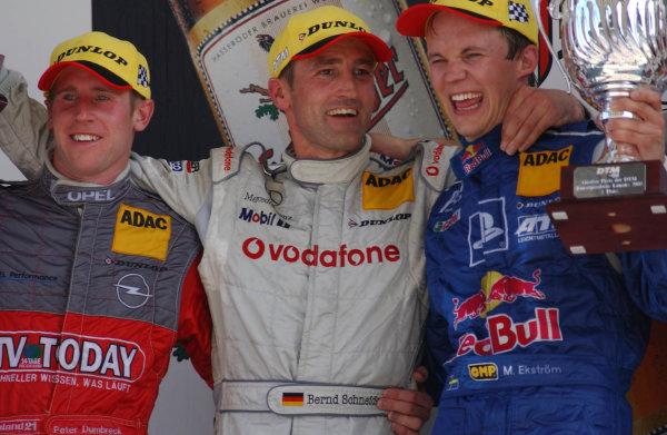 2003 DTM Championship Lausitz, Germany. 6th - 8th June 2003Race podium. Bernd Schneider (1st), Peter Dumbreck (2nd) and Mattias Ekstrom (3rd).World Copyright: Andre Irlmeier/LAT Photographic