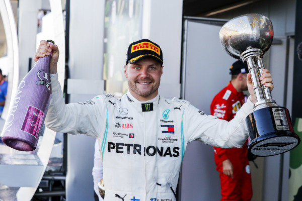 Valtteri Bottas, Mercedes AMG F1, 1st position, with his trophy and Champagne