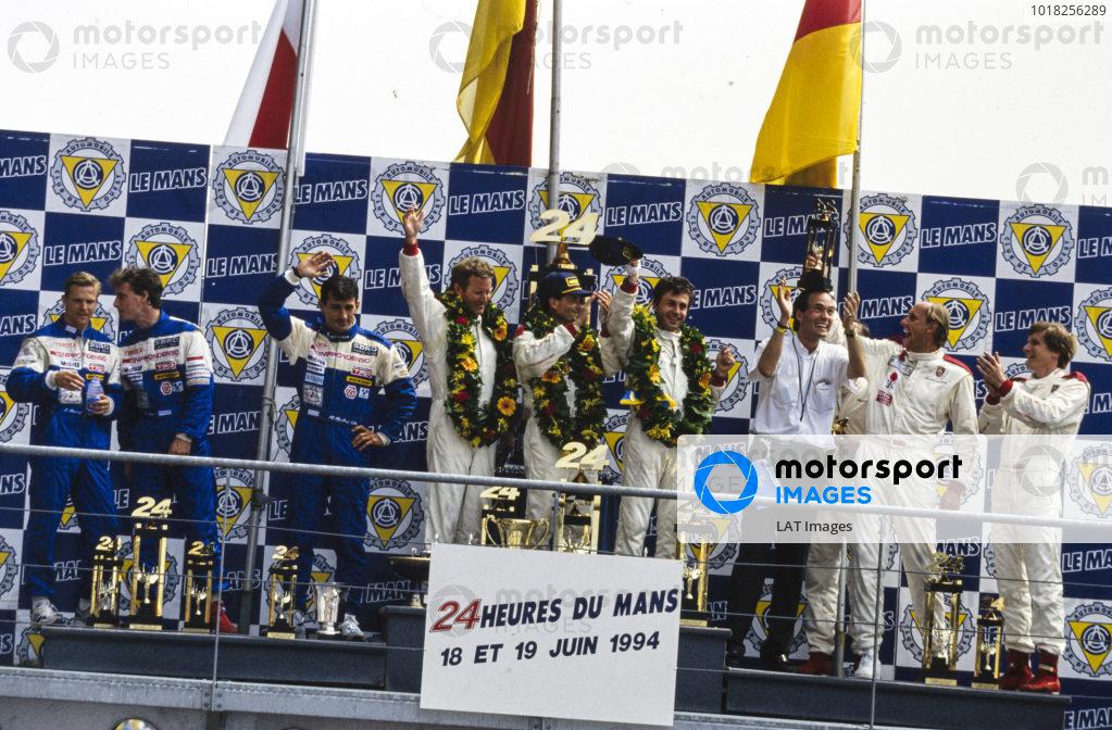 L to R: Jeff Krosnoff, Eddie Irvine, Mauro Martini / Jeff Krosnoff, Hurley Haywood, Mauro Baldi, Yannick Dalmas, Max Welti, Hans-Joachim Stuck Jr and Thierry Boutsen, celebrate on the podium.