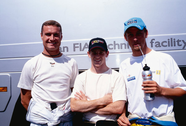 2002 Hungarian Grand Prix.Hungaroring, Budapest, Hungary. 16-18 August 2002.David Coulthard (McLaren Mercedes) with Grand Prix debutant Anthony Davidson (Minardi Asiatech) and Jenson Button (Renault). All three Brits were recipients of the McLaren Autosport BRDC Young Driver Award.Ref-02 HUN 03.World Copyright - Tee/LAT Photographic