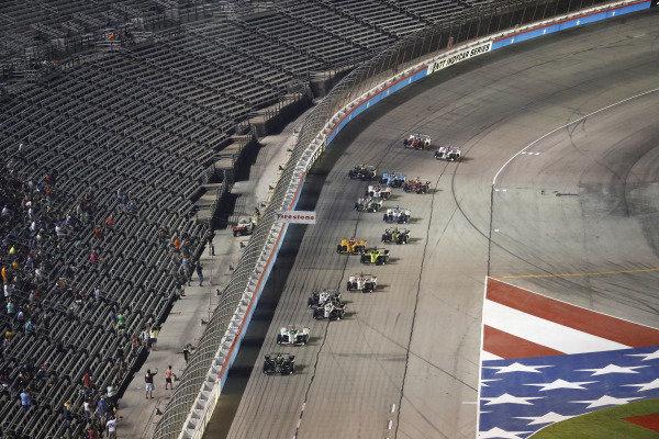 Josef Newgarden, Team Penske Chevrolet leads the final restart as Graham Rahal, Rahal Letterman Lanigan Racing Honda and Simon Pagenaud, Team Penske Chevrolet make contact
