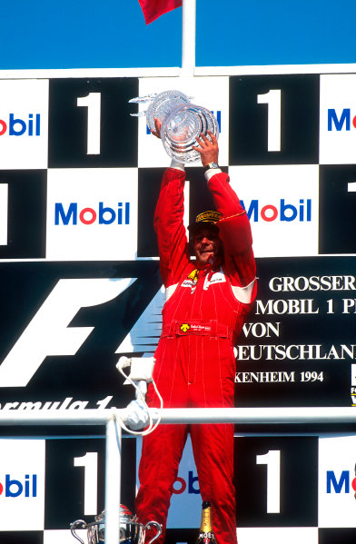 1994 German Grand Prix.Hockenheim, Germany.29-31 July 1994.Gerhard Berger (Ferrari) celebrates 1st position on the podium.Ref-94 GER 16.World Copyright - LAT Photographic