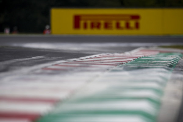 Cement dust covers the track, covering oil spilled in the previous Formula 2 session