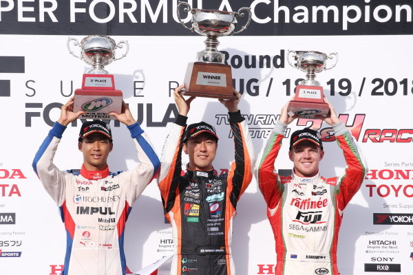 Race winner Hiroaki Ishiura, JMS P.mu/CERUMO - INGING SF14 Toyota, celebrates on the podium with second position Ryo Hirakawa, ITOCHU ENEX TEAM IMPUL SF14 Toyota, and third position Nick Cassidy, ORIENTALBIO KONDO SF14  Toyota.