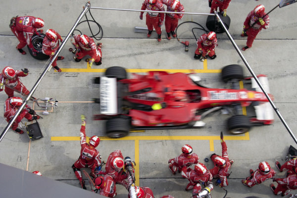 Michael Schumacher, Ferrari 248 F1 leaves his pitbox after his stop.