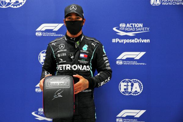 Lewis Hamilton, Mercedes-AMG Petronas F1, poses with the Pirelli Pole Position Award