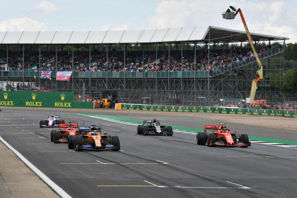 Carlos Sainz Jr., McLaren MCL34, Charles Leclerc, Ferrari SF90, Sebastian Vettel, Ferrari SF90, Romain Grosjean, Haas VF-19, and Lance Stroll, Racing Point RP19, practice starts at the end of the session