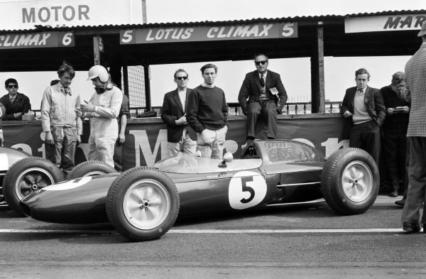 Jim Clark and Colin Chapman behind the Lotus 24 Climax in the pit lane.