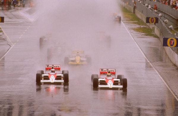 Adelaide, Australia.3-5 November 1989.Ayrton Senna leads teammate Alain Prost (both McLaren MP4/5 Honda's) with Pierluigi Martini (Minardi M189 Ford) behind in the spray at the start.Ref-89 AUS 04.World Copyright - LAT Photographic