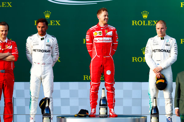Albert Park, Melbourne, Australia. Sunday 26 March 2017. Race winner Sebastian Vettel, Ferrari, on the podium between Lewis Hamilton, Mercedes AMG, 2nd, and Valtteri Bottas, Mercedes AMG. Luigi Fraboni, Head of Power Unit Race Operation, Ferrari, stands to Hamilton's right. World Copyright: Sam Bloxham/LAT Images ref: Digital Image _J6I5087