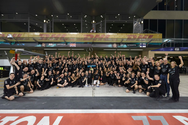 Yas Marina Circuit, Abu Dhabi, United Arab Emirates. Sunday 26 November 2017. Toto Wolff, Executive Director (Business), Mercedes AMG, Valtteri Bottas, Mercedes AMG, 1st Position, his wife Emelia, Lewis Hamilton, Mercedes AMG, 2nd Position, and the Mercedes team celebrate a great race result and another highly successful season. World Copyright: Steve Etherington/LAT Images  ref: Digital Image SNE21328