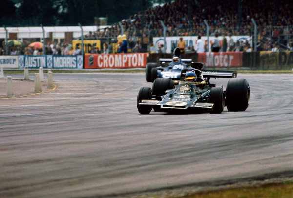 1973 British Grand Prix.  Silverstone, England. 12-14 July 1973.  Ronnie Peterson, Lotus 72E-Ford, 2nd position, leads Jackie Stewart, Tyrrell 006 Ford, 10th position.  Ref: 73GB83. World Copyright: LAT Photographic.