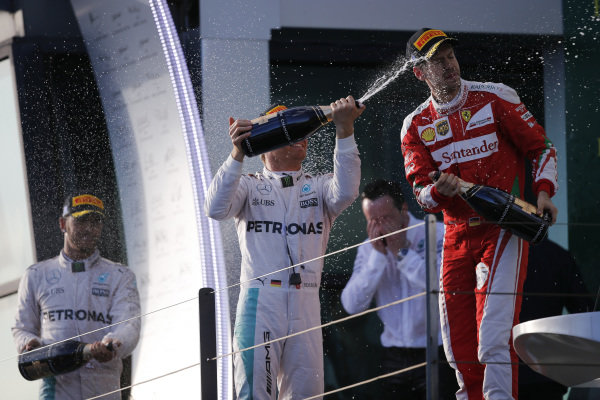 Race winner Nico Rosberg (GER) Mercedes AMG F1, Lewis Hamilton (GBR) Mercedes AMG F1 and Sebastian Vettel (GER) Ferrari celebrate with champagne on the podium at Formula One World Championship, Rd1, Australian Grand Prix, Race, Albert Park, Melbourne, Australia, Sunday 20 March 2016.