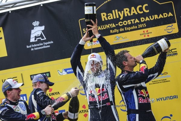 Rally winners Andreas Mikkelsen (NOR) / Ola Floene (NOR) Volkswagen WRC celebrate on the podium with the champagne at FIA World Rally Championship, Rd12, RAAC Rally de Espana, Day Three, Costa Daurada, Catalunya, Spain, 25 October 2015.