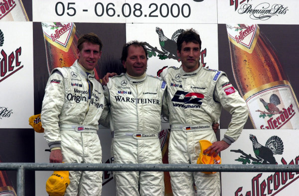 2000 DTM ChampionshipSachsenring, Germany. 6th August 2000. Rd 5/10.Race 1 podium and a trio of Mercedes drivers. Peter Dumbreck, 2nd, Klaus Ludwig, 1st and Bernd schneider, 3rd.World - hardwick / LAT Photographic