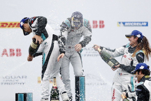 The PRO and PRO AM podiums celebrate with champagne spray