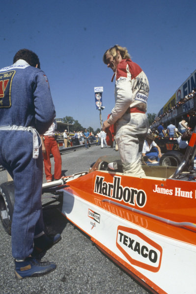 James Hunt talks to Jody Scheckter in the pit lane.