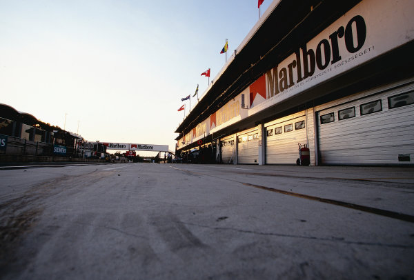 2002 Hungarian Grand Prix.Hungaroring, Budapest, Hungary. 16-18 August 2002.An atmospheric view of the pit lane and garages at the Hungaroring circuit. Unfortunately, the Arrows garage remained empty over the weekend, after they failed to turn up, still trying to resolve their financial problems.Ref-02 HUN 02.World Copyright - Bellanca/LAT Photographic