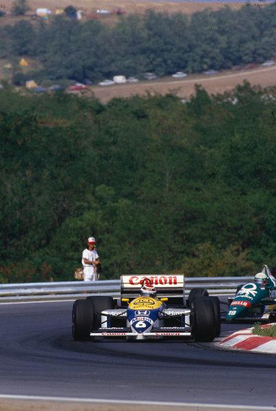 1986 Hungarian Grand Prix.Hungaroring, Budapest, Hungary.8-10 August 1986.Nelson Piquet (Williams FW11 Honda) 1st position.Ref-86 HUN 36.World Copyright - LAT Photographic