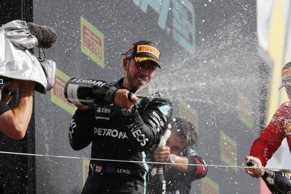 Sir Lewis Hamilton, Mercedes, 1st position, sprays Champagne on the podium