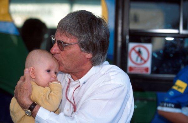 F1 Supremo Bernie Ecclestone (GBR) kisses a baby. Italian Grand Prix, Monza, 10 September 1995.
