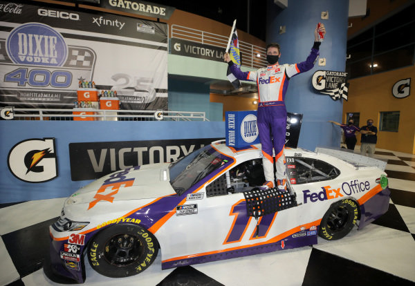 Race winner Denny Hamlin, Joe Gibbs Racing Toyota, Copyright: Chris Graythen/Getty Images.