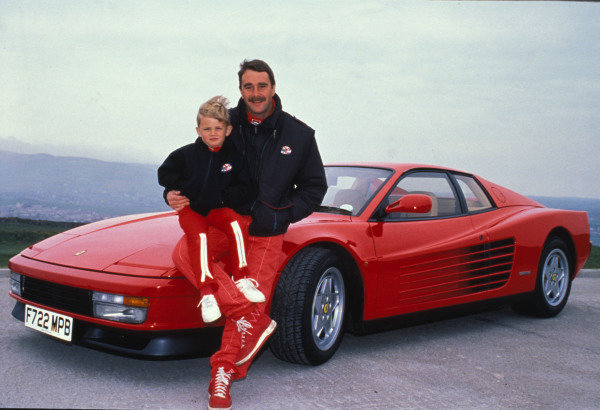 Isle of Man, United Kingdon. 18/4/1989. Nigel Mansell poses in front of a Ferrari Testarossa with his son Leo