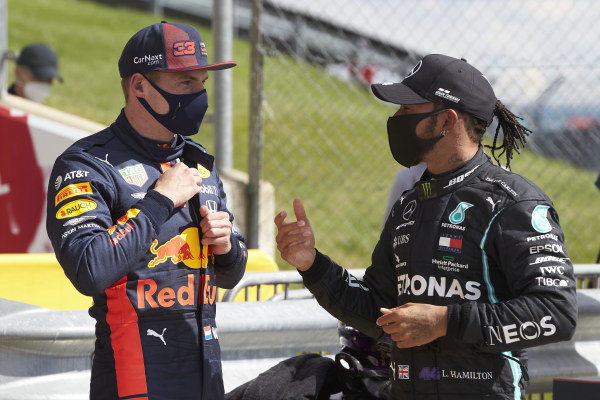 Lewis Hamilton, Mercedes-AMG Petronas F1, talks to Max Verstappen, Red Bull Racing in parc ferme