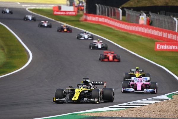 Daniel Ricciardo, Renault R.S.20, leads Lance Stroll, Racing Point RP20, and Esteban Ocon, Renault R.S.20