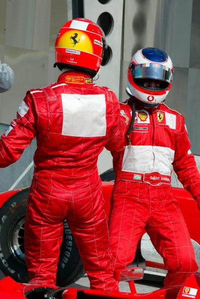 2002 American Grand Prix.Indianapolis, Indiana, USA. 27-29 September 2002.Michael Schumacher (Ferrari) 2nd position and Rubens Barrichello (Ferrari) 1st position in parc ferme.World Copyright - LAT Photographicref: Digital File Only