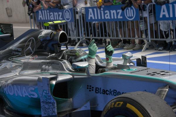 Nico Rosberg, Mercedes F1 W05 Hybrid celebrates victory as he pulls into parc ferme.