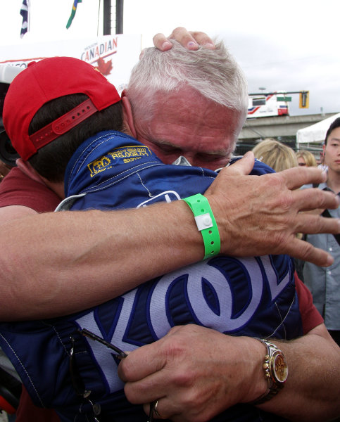 2002 Vancouver CART, 28 July, 2002, Vancouver, CanadaGreg Moore's father Ric hugs Dario Franchitti after he won the race-2002, Lesley Ann Miller, USALAT Photographic