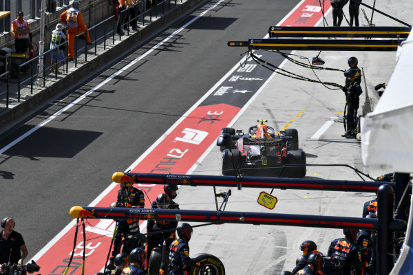 Pierre Gasly, Red Bull Racing RB15, leaves his pit box after a stop