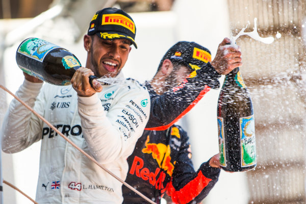 Circuit de Catalunya, Barcelona, Spain. Sunday 14 May 2017. Lewis Hamilton, Mercedes AMG, 1st Position, and Daniel Ricciardo, Red Bull Racing, 3rd Position, spray the Champagne on the podium. World Copyright: Dom Romney/LAT Images ref: Digital Image GT2R1877