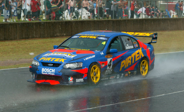 Australian V8 Supercars, Round 13, Eastern Creek, Sydney. 30th Nov 2003.Ford driver Marcos Ambrose takes victory in race 2 to win the 2003 V8 Supercar Championship at the VIP Petfoods Main Event at Eastern Creek International Raceway 20km west of Sydney NSW, Australia.Photo: Mark Horsburgh/LAT Photographic
