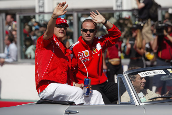 2004 French Grand Prix - Sunday Race, Magny Cours, France. 04th July 2004 Ferrari team mates Michael Schumacher and Rubens Barrichello, wave to the crowds on the drivers parade.World Copyright: Steve Etherington/LAT Photographic ref: Digital Image Only