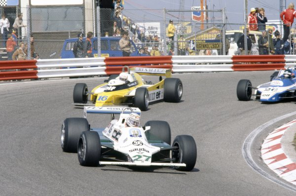 1980 Dutch Grand Prix.Zandvoort, Holland. 29-31 August 1980.Alan Jones (Williams FW07B-Ford Cosworth) leads Rene Arnoux (Renault RE20) and Jacques Laffite (Ligier JS11/15-Ford Cosworth).World Copyright: LAT PhotographicRef: 35mm transparency 80HOL10