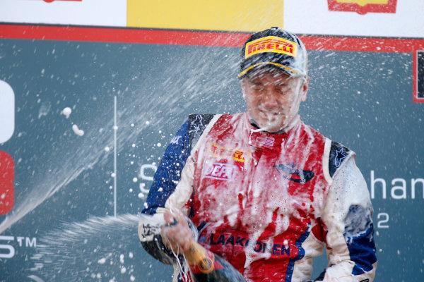 Circuit de Spa-Francorchamps, Spa, Belgium. 2nd September 2012. Sunday Race 2.1st place Matias Laine (FIN, MW Arden) celebrates on the podium. Portrait. World Copyright: Glenn Dunbar/LAT Photographic Ref: Digital Image _89P2894.jpg