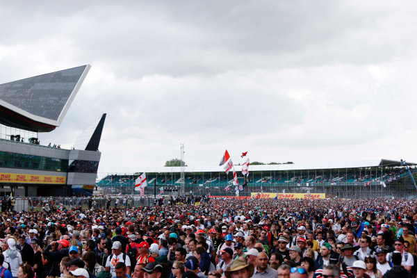 Silverstone, Northamptonshire, England. Sunday 5 July 2015. Fans invade the circuit after the race to see the podium celebrations. World Copyright: Zak Mauger/LAT Photographic. ref: Digital Image _L0U6635