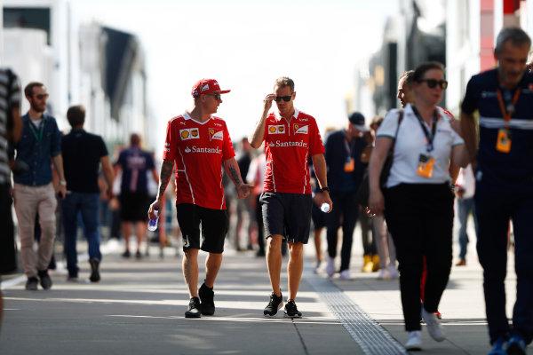 Hungaroring, Budapest, Hungary.  Friday 28 July 2017. Kimi Raikkonen, Ferrari, and Sebastian Vettel, Ferrari. World Copyright: Glenn Dunbar/LAT Images  ref: Digital Image _31I8988