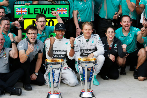 Circuit of the Americas, Austin, Texas, United States of America. Sunday 2 November 2014. Lewis Hamilton, Mercedes AMG, 1st Position, Nico Rosberg, Mercedes AMG, 2nd Position, and the Mercedes team celebrate victory. World Copyright: Charles Coates/LAT Photographic. ref: Digital Image _N7T5644