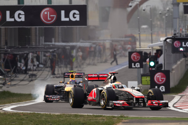 Korea International Circuit, Yeongam-Gun,South Korea. 16th October 2011. Lewis Hamilton, McLaren MP4-26 Mercedes, 2nd position, leads Mark Webber, Red Bull Racing RB7 Renault, 3rd position. Action. Pit Stops.  World Copyright:Steve Etherington/LAT Photographic ref: Digital Image SNE21460