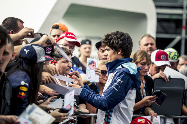 Lance Stroll (CDN) Williams signs autographs for the fans