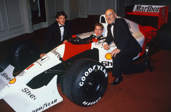 1991 Autosport Awards. Grosvenor House Hotel, Park Lane, London.  8th December 1991. Ayrton Senna presents Oliver Gavin with the Autosport Young Driver of the Year Award with Stirling Moss, portrait.  World Copyright: LAT Photographic. Ref:  Colour Transparency.