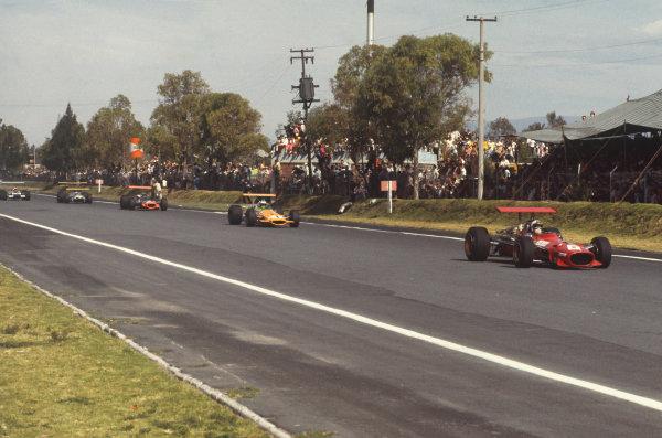 1968 Mexican Grand Prix.  Mexico City, Mexico. 1st-3rd November 1968.  Chris Amon, Ferrari 312, leads Denny Hulme, McLaren M7A Ford, Pedro Rodriguez, BRM P133, Jochen Rindt, Brabham BT26 Repco, and Jo Siffert, Lotus 49B Ford.  Ref: 68MEX61. World Copyright: LAT Photographic
