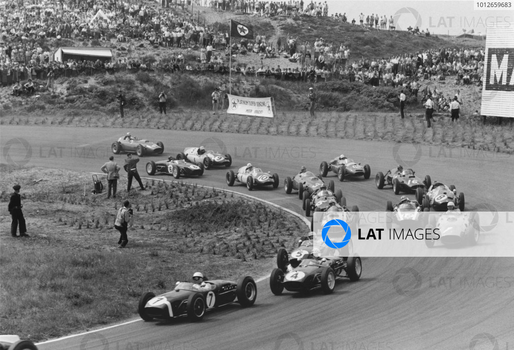 Zandvoort, Holland. 6th June 1960.With the leaders gone Stirling Moss, Lotus 18-Climax, 4th position, leads Innes Ireland, Lotus 18-Climax, 2nd position, Alan Stacey, Lotus 18-Climax, retired, Phil Hill, Ferrari Dino 246, retired, Jo Bonnier, BRM P48, retired, Bruce McLaren, Cooper T53-Climax, retired, Dan Gurney, BRM P48, retired, Chris Bristow, Cooper T51-Climax, retired, Richie Ginther, Ferrari Dino 246, 6th position, Graham Hill, BRM P48, 3rd position, Maurice Trintignant, Cooper T51-Maserati, retired, Henry Taylor, Cooper T51-Climax, 7th position, Tony Brooks, Cooper T51-Climax, retired, Jim Clark, Lotus 18-Climax, retired, and Wolfgang von Trips, Ferrari Dino 246, 5th position, at the start, action.World Copyright: LAT PhotographicRef: Autosport b&w print.